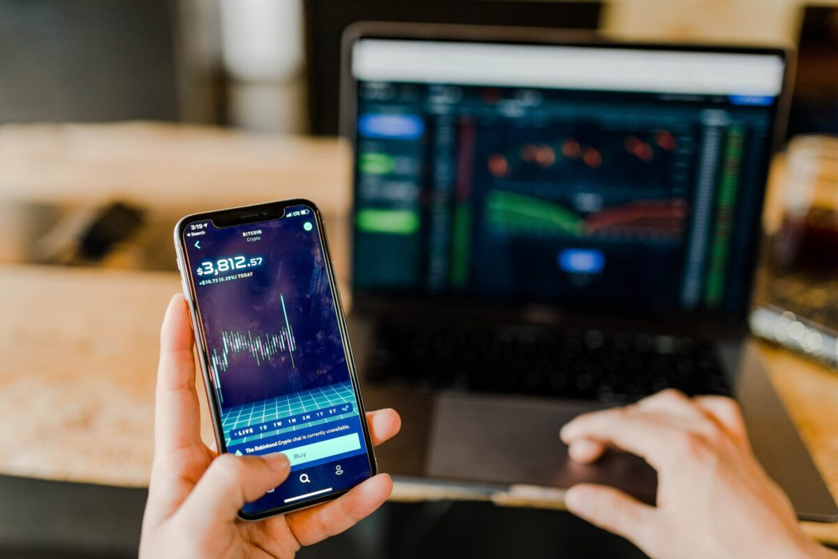 crypto trading on mobilephone and laptop
